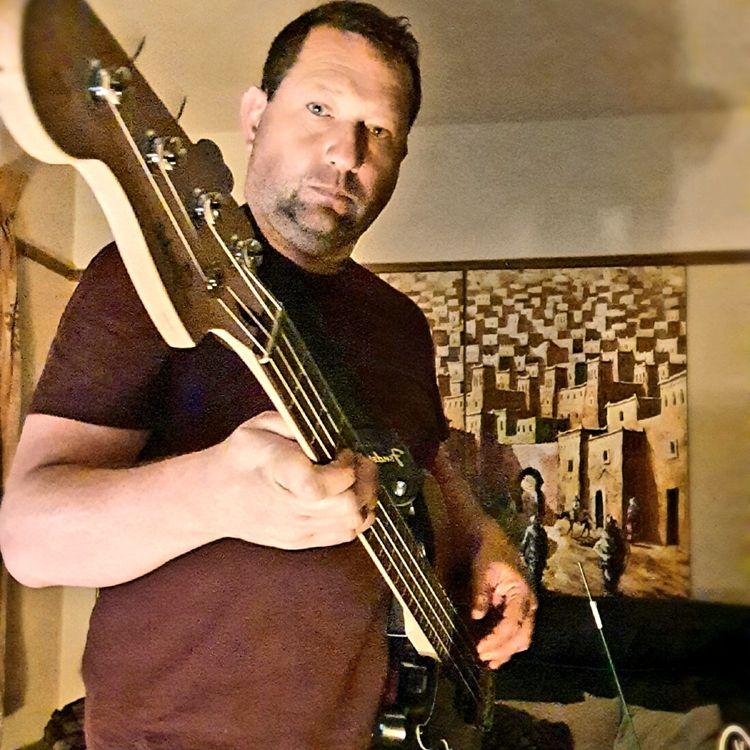 playing bass - wickhamai   ello