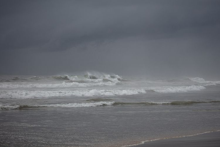 Tromping wet sand, making photo - tchickphoto   ello