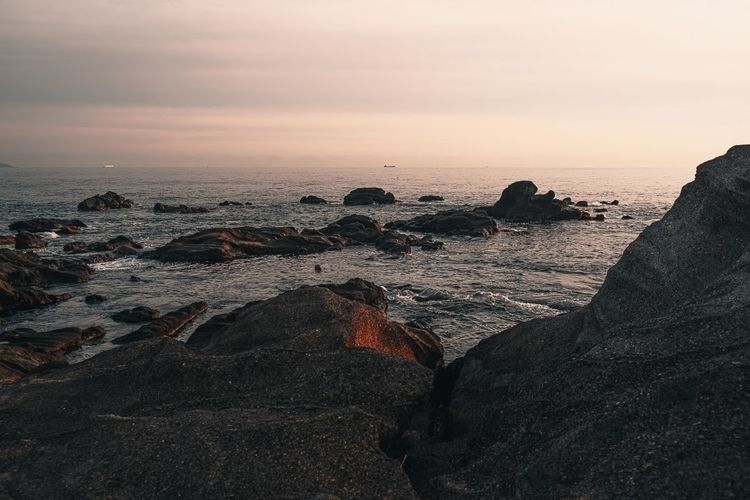 Sunset rocks watching shipping  - fokality | ello