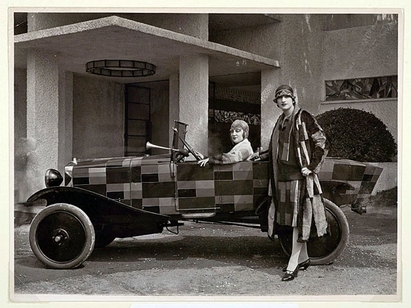 A 'simultaneous' dress by Sonia Delaunay next to a Citroen B12, the first car she designed (1925)