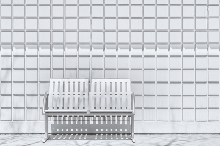 Metal Bench Against Concrete Squares FKR.jpg