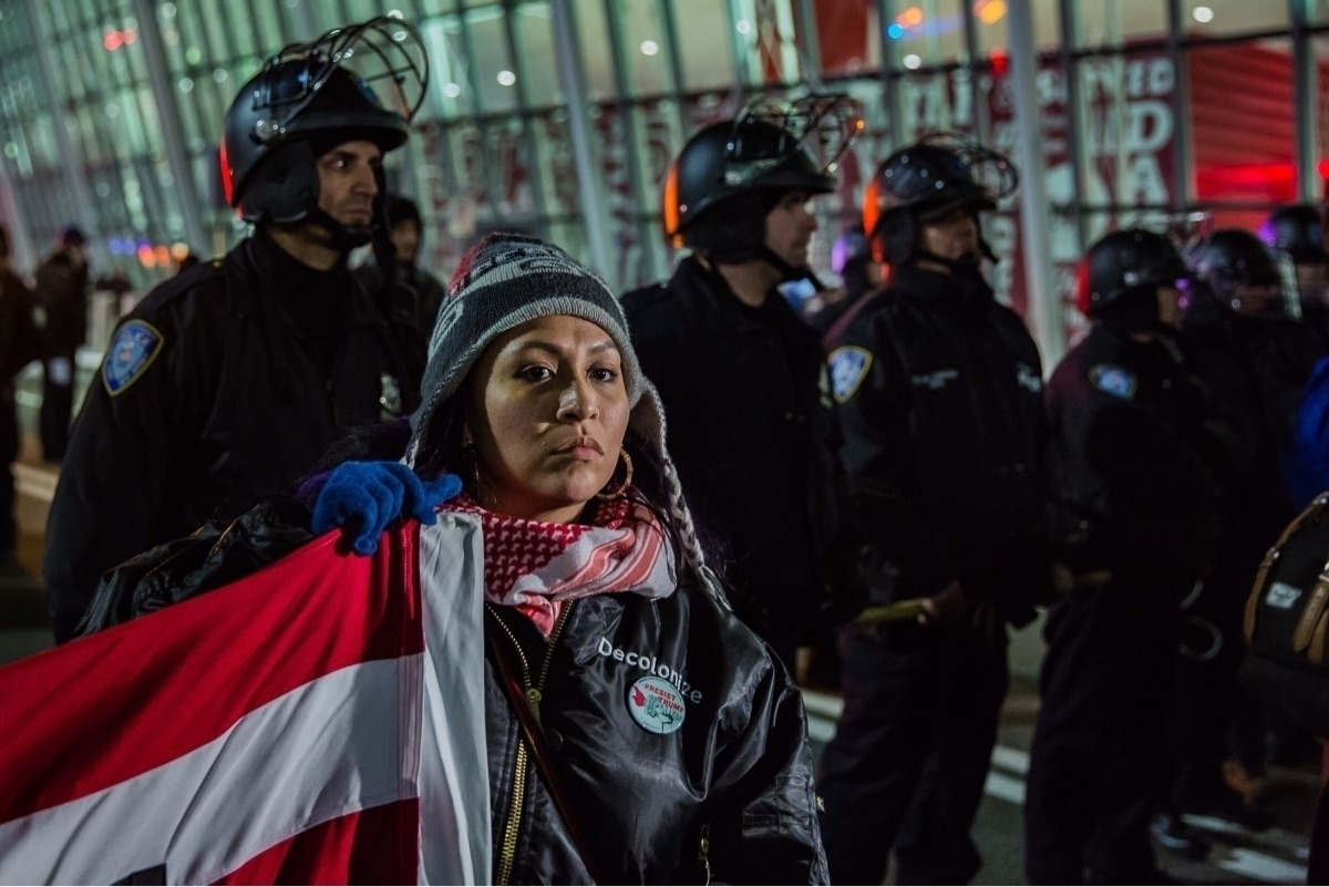 Protesters stand resolute JFK r - daniel_mcknight | ello