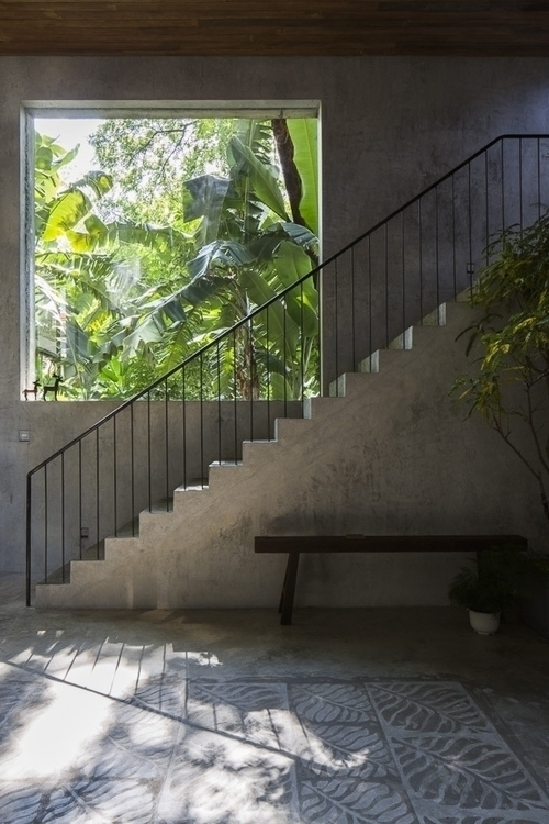 Concrete stairs large window. T - upinteriors | ello