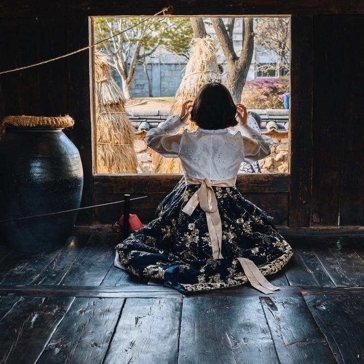 woman dressed hanbok sits windo - indiga   ello