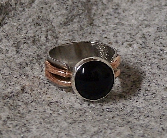 Onyx ring stainless steel coppe - wolfgangschweizer | ello
