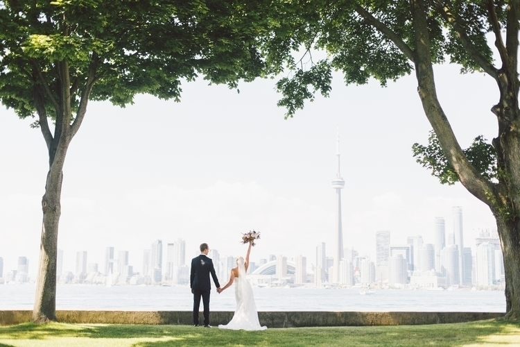 Bride Groom facing Toronto skyl - purpletree | ello