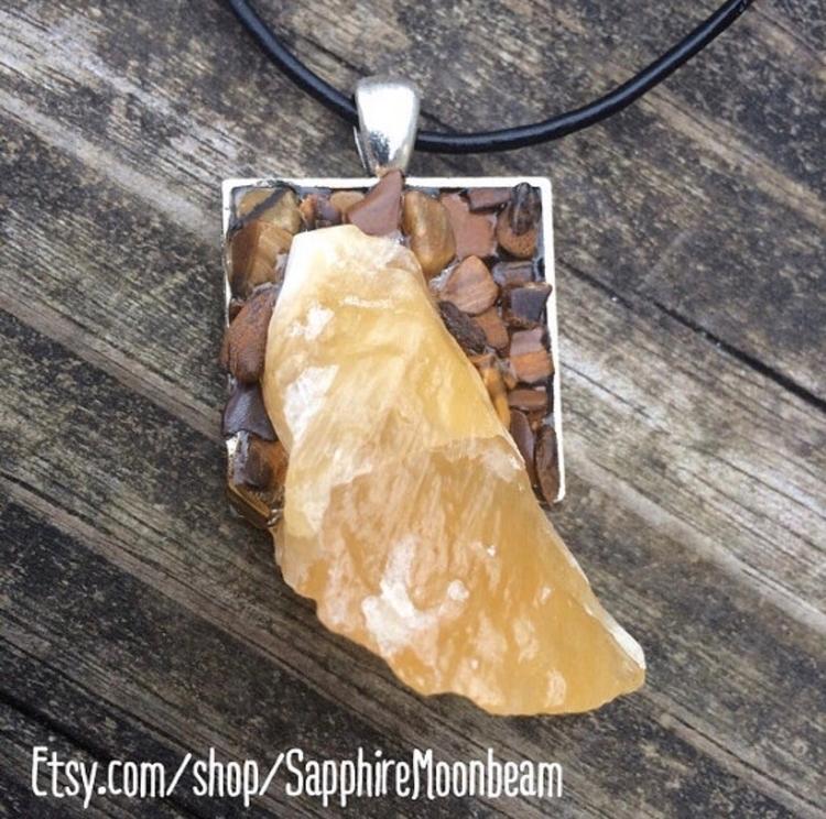 orange Calcite slice sits surro - sapphiremoonbeam | ello