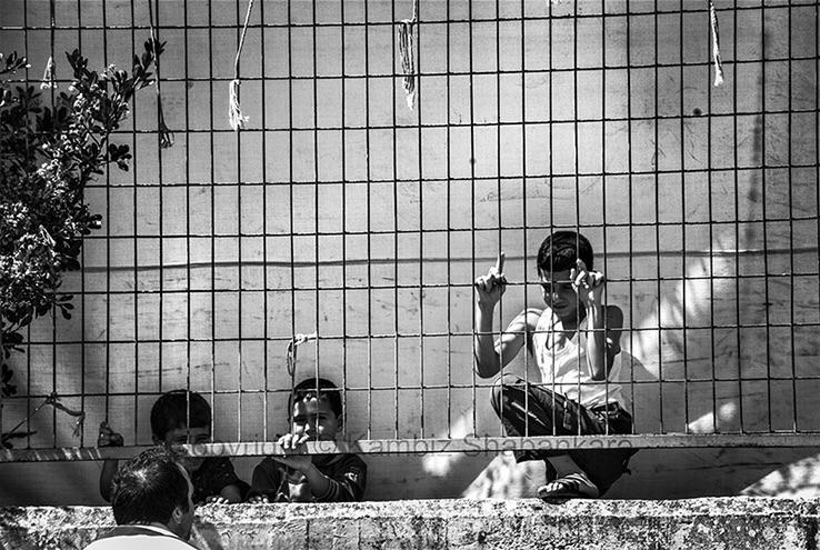 Syrian Children fence refugee c - kambizs | ello