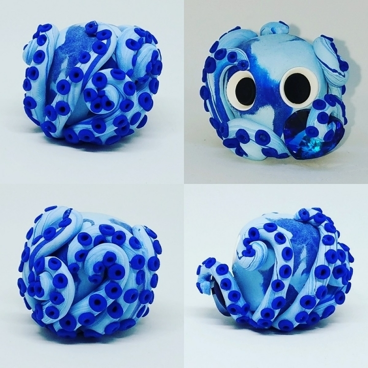 holding IG - blue, octopus, blueswarovskiheart - camian | ello