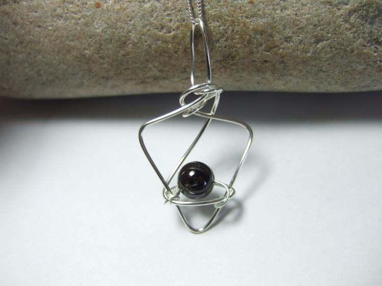 Silver wire design dark garnet  - silverwiredesigns | ello