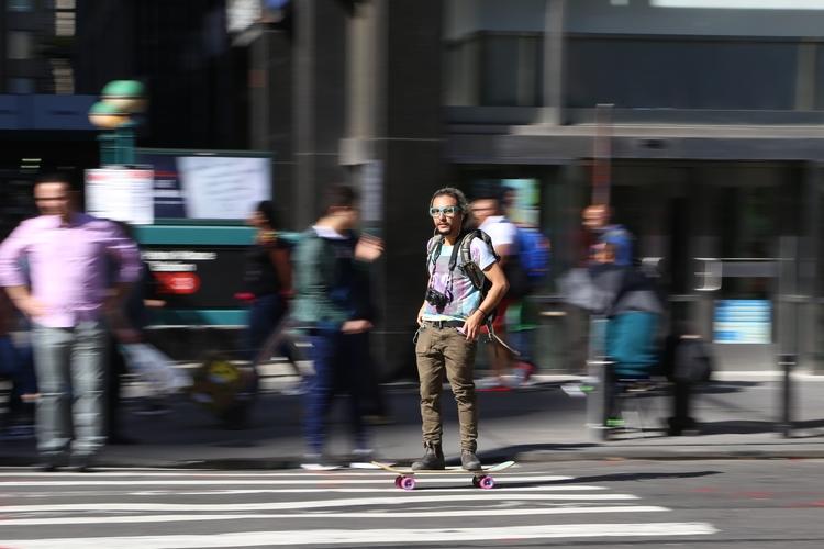 Motion** skateboarder passing a - kevinrubin   ello