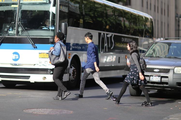 **3 people crossing 5th Avenue  - kevinrubin | ello