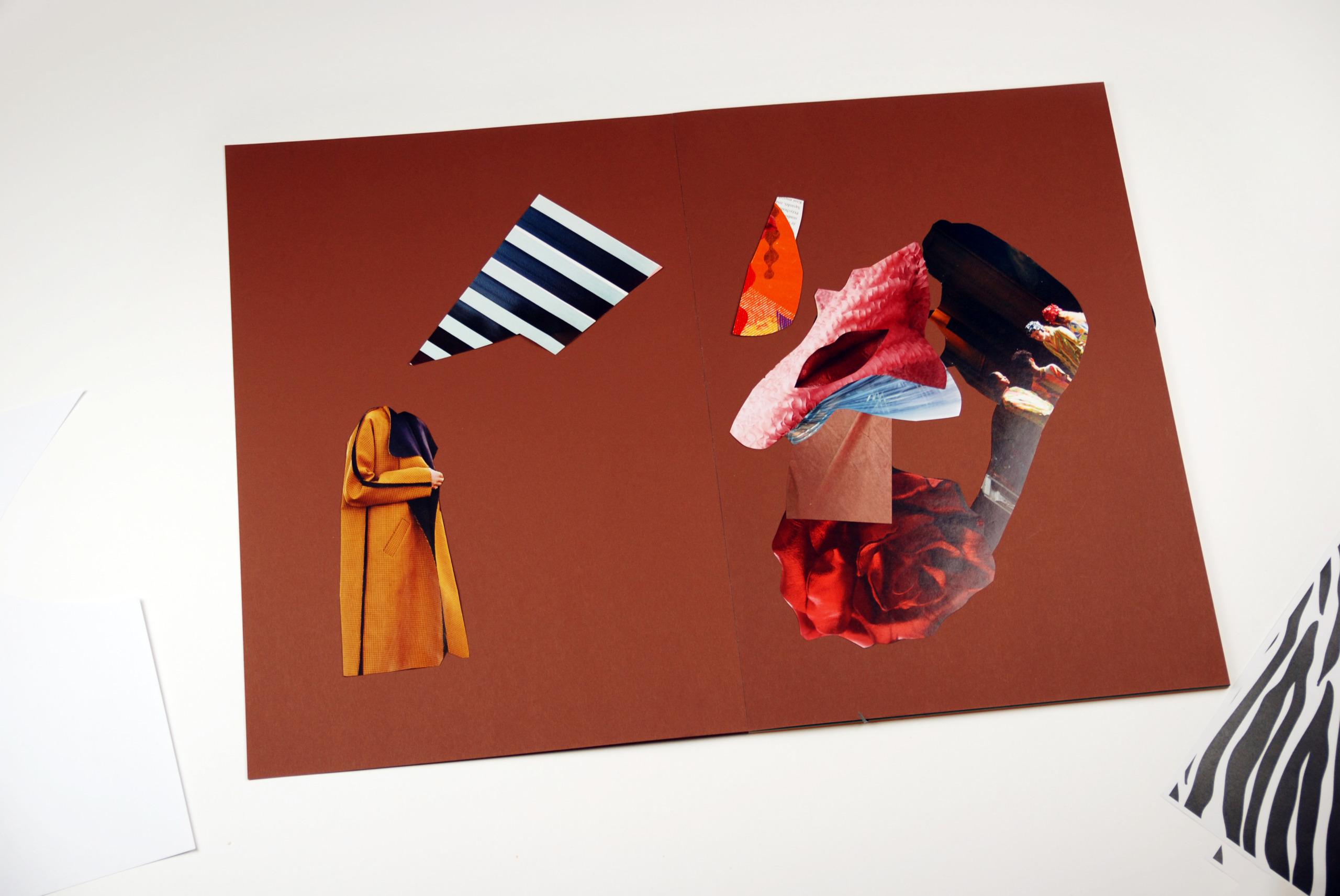 Zdjęcie przedstawia elementy powycinane z gazet położone na brązowym kartonie.