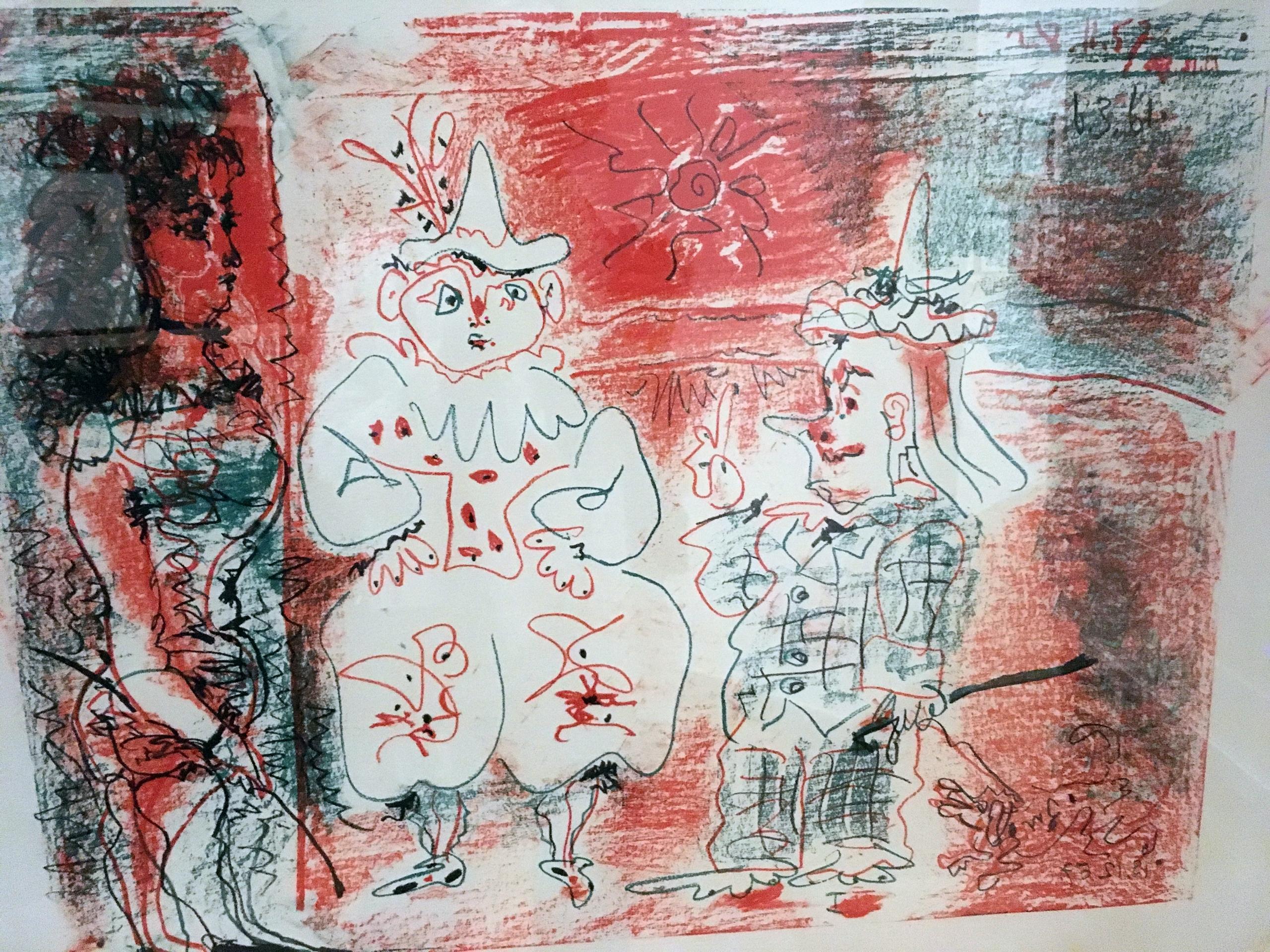 Zdjęcie przedstawia pracę znanego artysty Pabla Picassa. Praca wykonana jest w graficznej technice, widzimy postaci i ekspresyjny czerwony kolor.