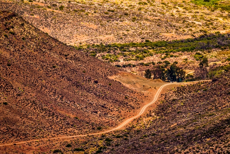 downhill snaky country road - SouthAfrica - christofkessemeier | ello