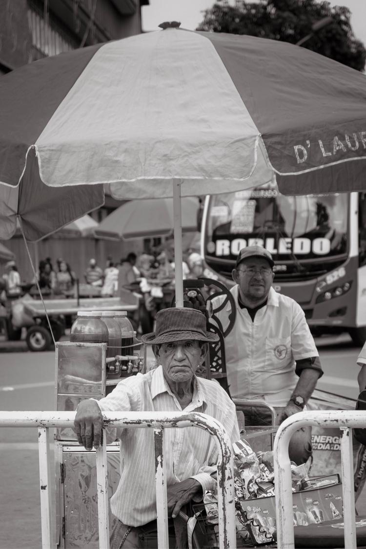 Ice cream man takes - streetphotography - kch | ello