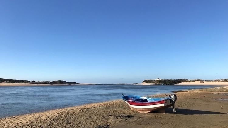 Fishing boat grounded Rio Mira  - ollieharding | ello