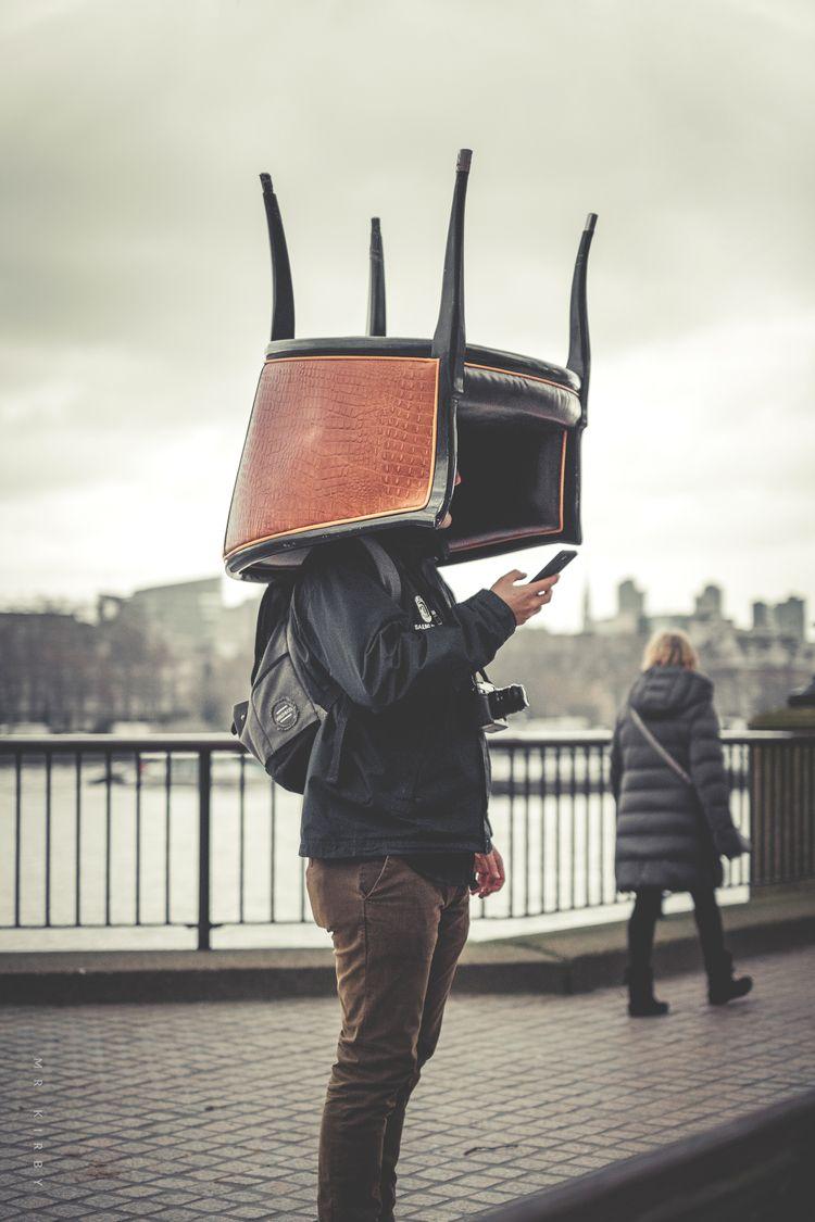 sits hat.  - fujifilm, streetphotography - mrkirby | ello