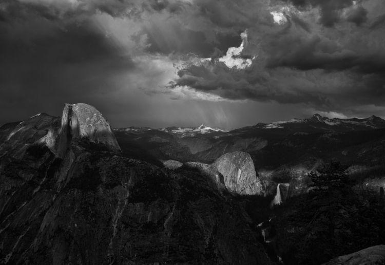 Light breaking storm clouds Dom - aaronvizzini   ello