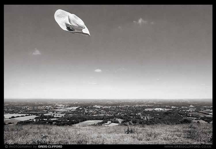 Sun-hat floating hilltop summer - greigclifford | ello
