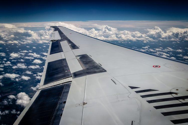 Clouds wing American Airlines M - mattgharvey | ello