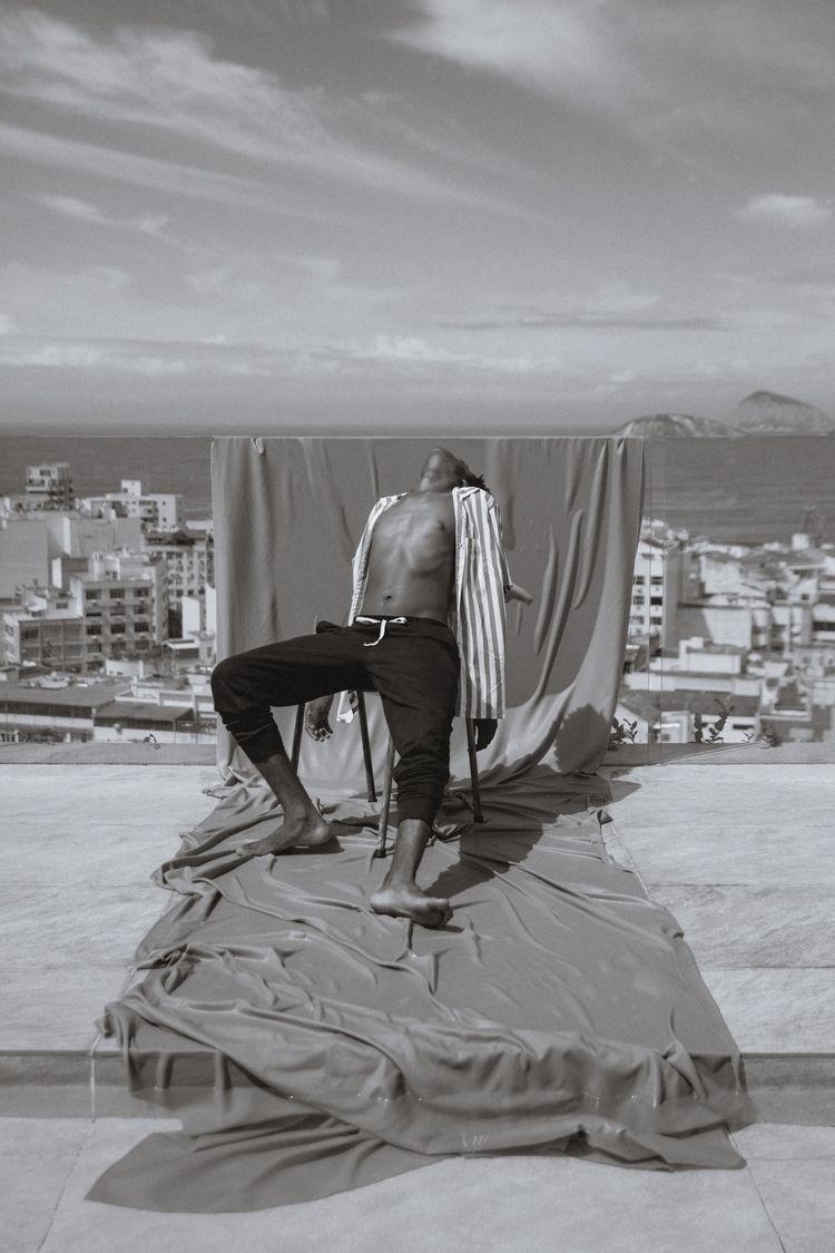 man, city, ocean sky editorial  - andressaguerra | ello